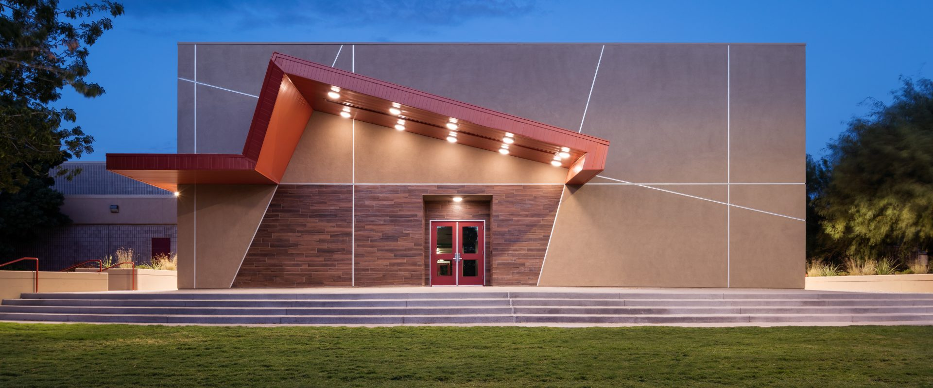 Exterior twilight view of the Winchester Cultural Center extension in Las Vegas, NV.